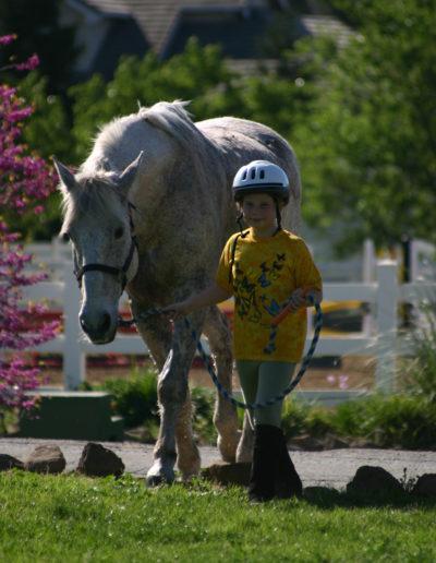 girl walking horse